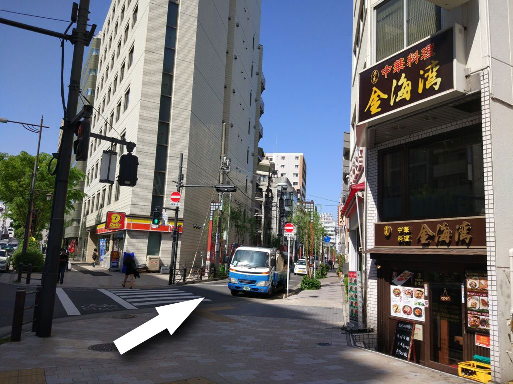 2.Go diagonally right to the street between chinese restaurant(around the corner) and convenience store.
